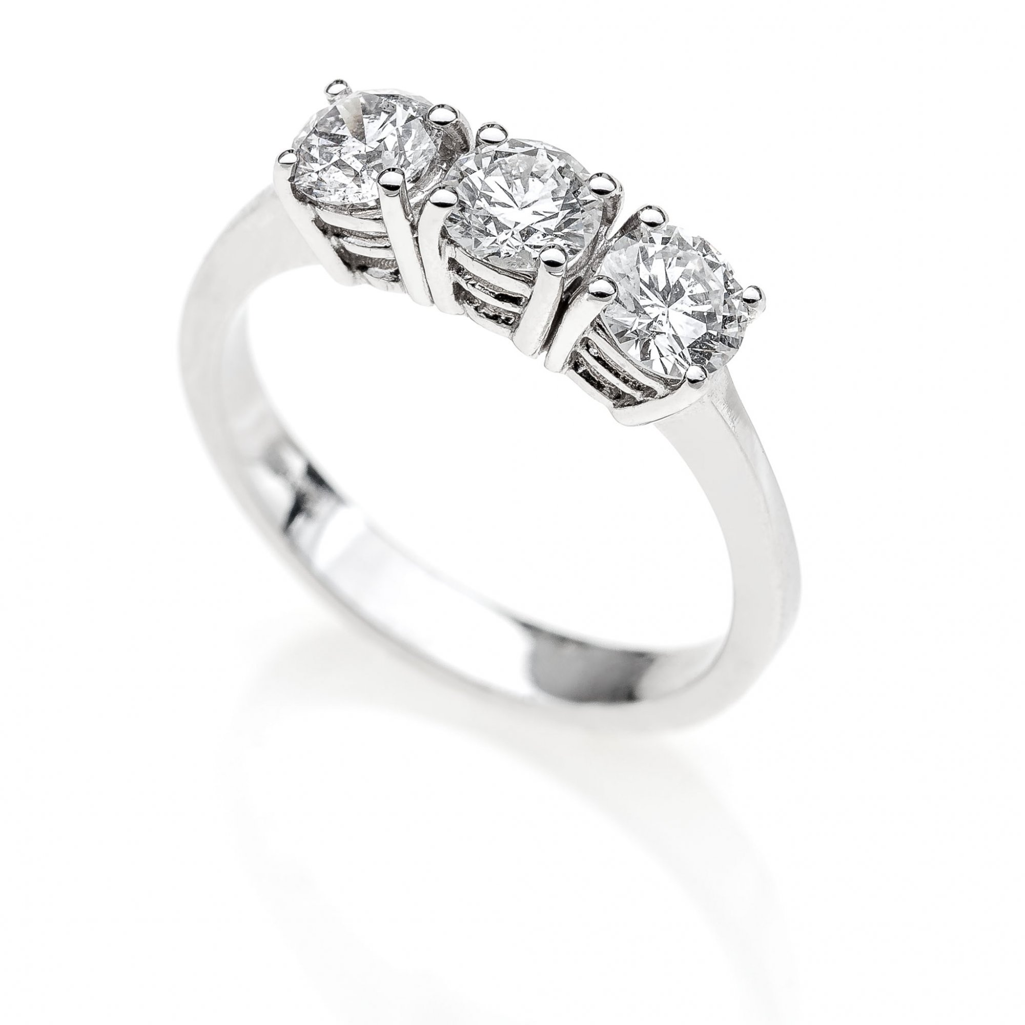18 KT white gold Trilogy ring with round brilliant cut ct.1.20 VVS1 F color