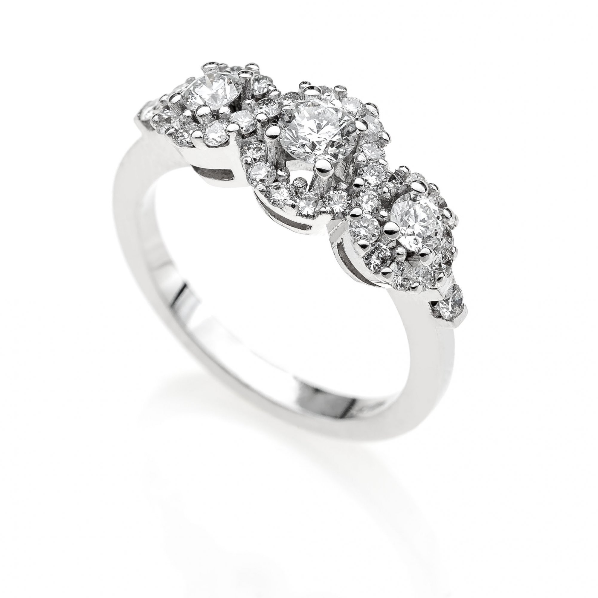 18 KT white gold trilogy ring with round brilliant cut diamonds ct.0.90 + ct.0.20 VVS F color
