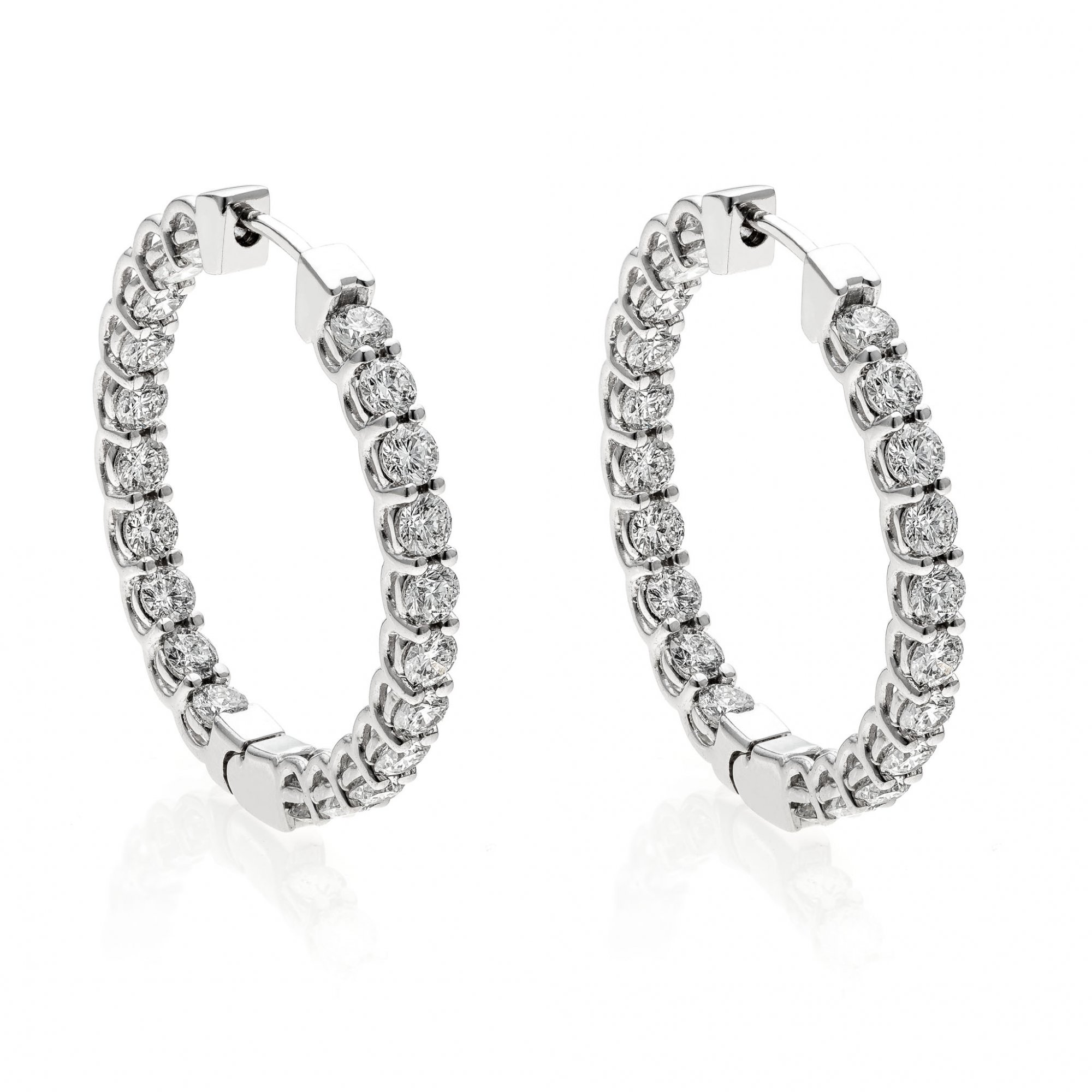 18 KT white gold earrings with round brilliant cut diamonds ct.1.20 VS1 G color
