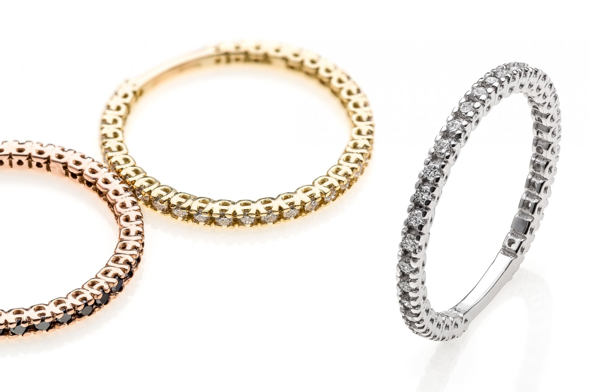 Eternity rings in 18 KT white,yellow and pink gold white round brilliant cut diamonds and black diamonds